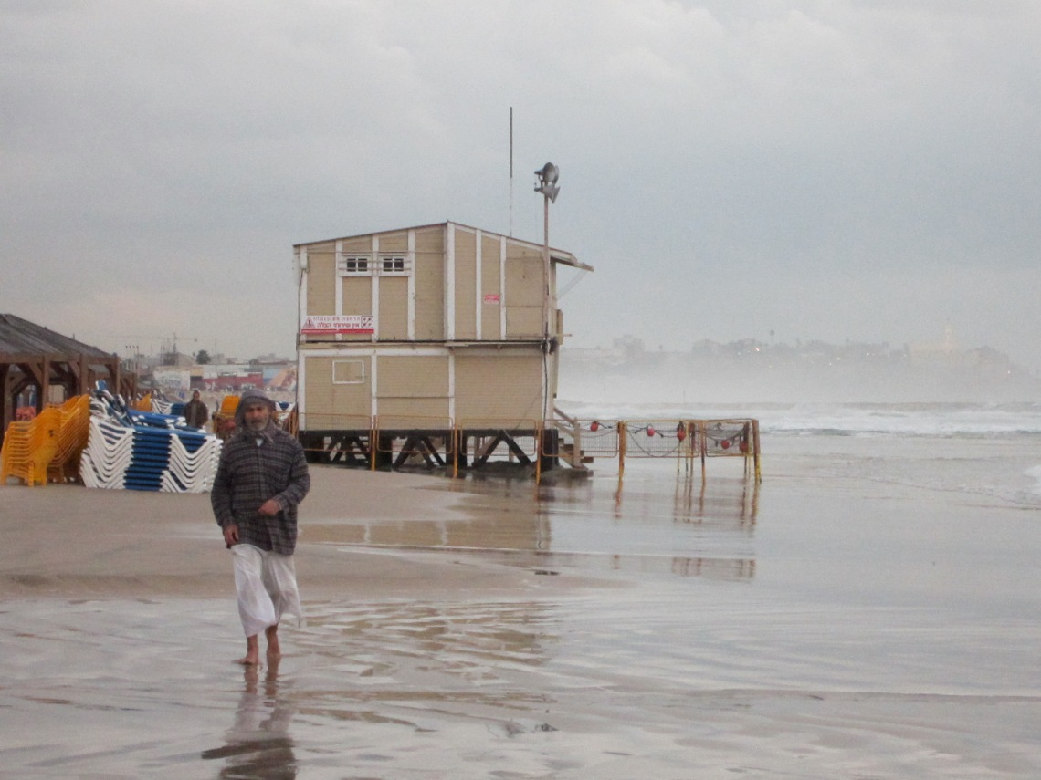 Man walking on beach in Tel Aviv, Israel